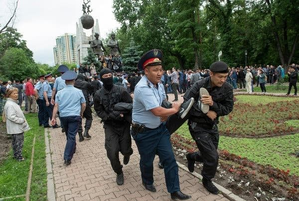 Security officers in Almaty, Kazakhstan, detained demonstrators on Sunday.